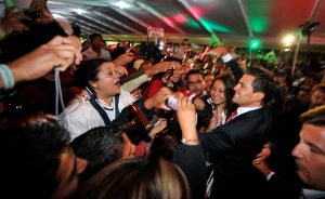 Enrique Pena Nieto with supporters. Photograph: Daniel Aguilar/Getty Images