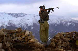 "Kurdish peshmerga--literally ""those who face death""--standing guard at Shenarwe Mountain"